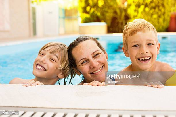 Mother and sons in the pool
