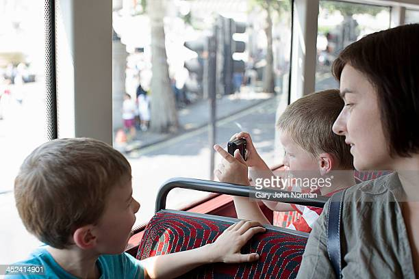Mother and sons on double decker bus in London