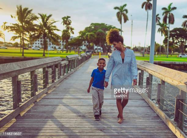 mother and sun on the pier attractive african american family - west palm beach stock pictures, royalty-free photos & images