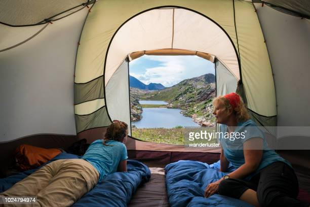 Mother and teen daughter camping at high elevation, Colorado
