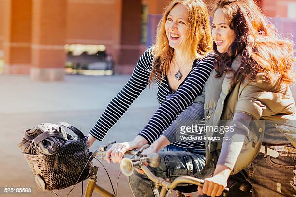 mother and teen daughter riding bikes together - menopause stock pictures, royalty-free photos & images