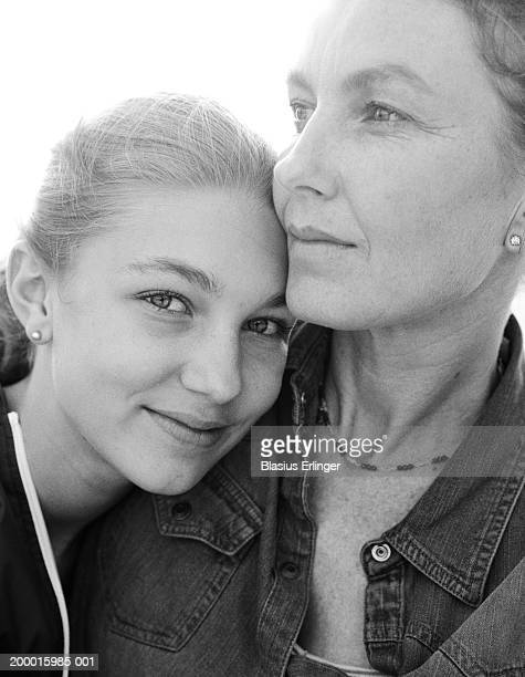 mother and teenage daughter (13-15), portrait (b&w) - blasius erlinger stock pictures, royalty-free photos & images