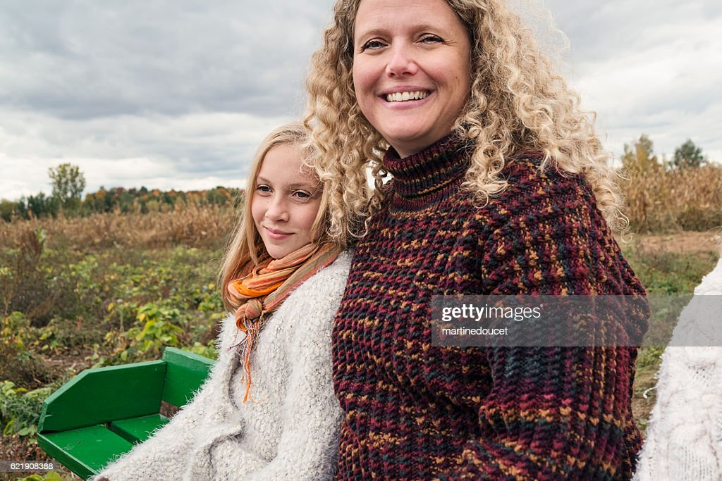 Mother And Teenage Daughter Strolling In Trailer In Field Stock
