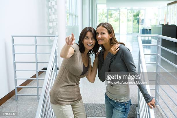 mother and teenage girl together, woman pointing out of frame - out of frame stock pictures, royalty-free photos & images