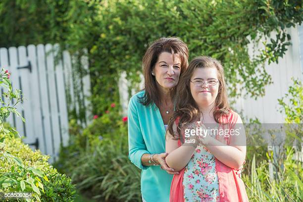 Mother and teenage girl with down syndrome