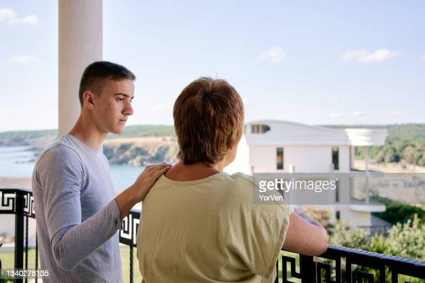 mother and teenage son arguing at home - single mother stock pictures, royalty-free photos & images