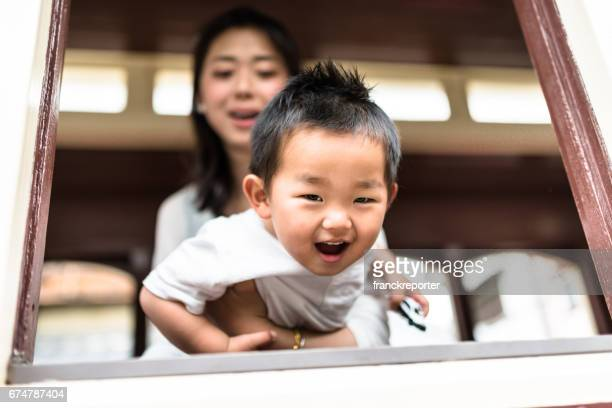 mother and the son together have fun - chinese mothers day stock pictures, royalty-free photos & images