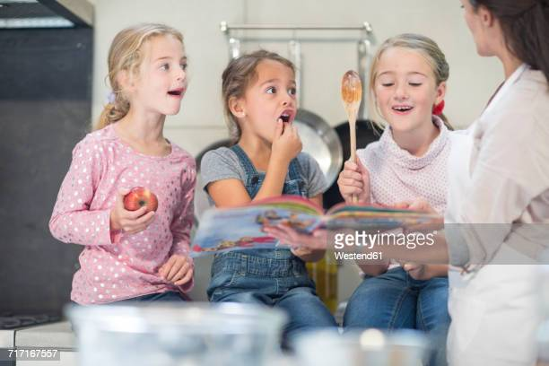 Mother and three girls in kitchen
