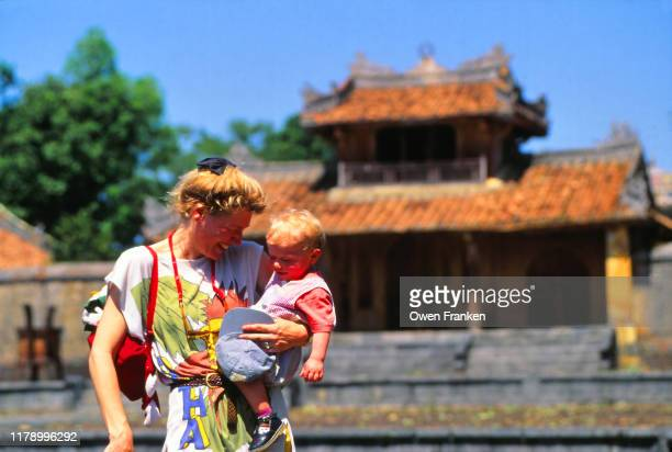 mother and three year old son on vacation in vietnam - image stock pictures, royalty-free photos & images