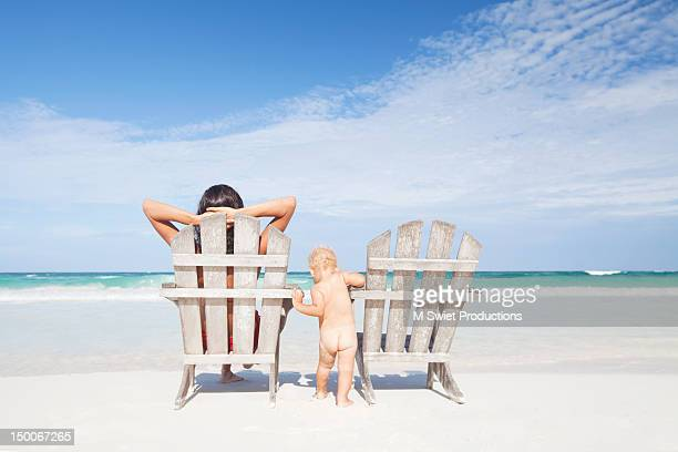 Mother and toddler boy at beach