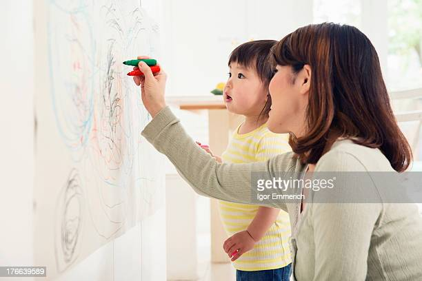 Mother and toddler drawing