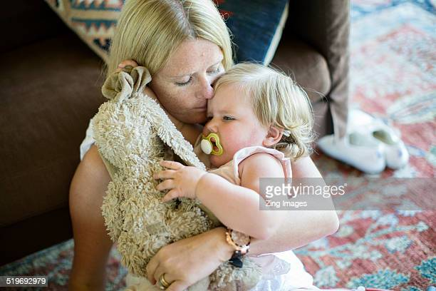 Mother and toddler embracing