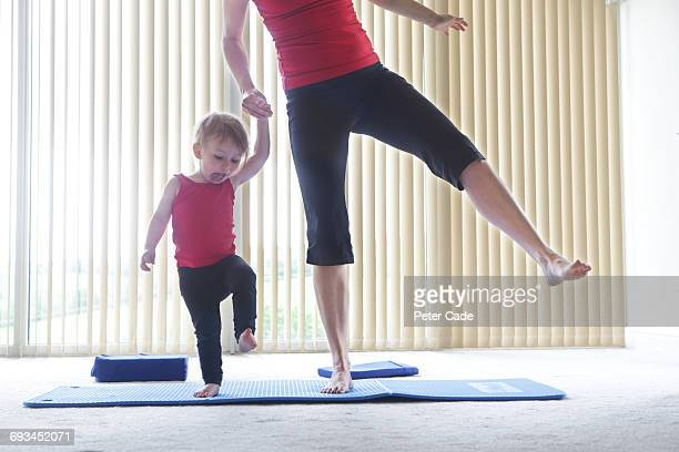 Mother and toddler exercising at home