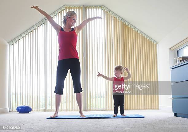 Mother and toddler exercising together