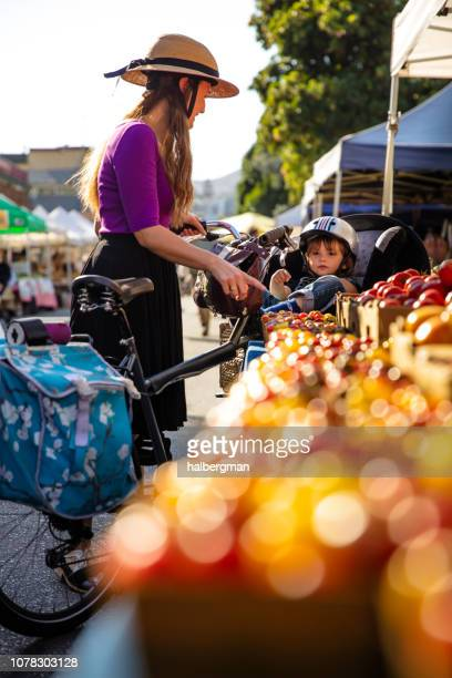 Mother and Toddler Selecting Tomatoes at Farmer's Market
