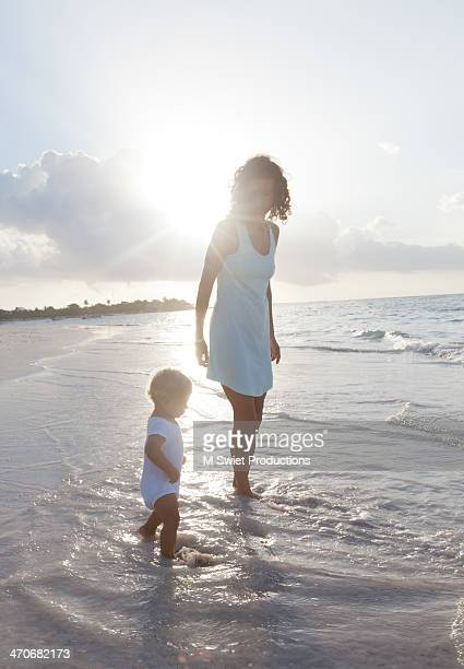 mother and toddler son beach