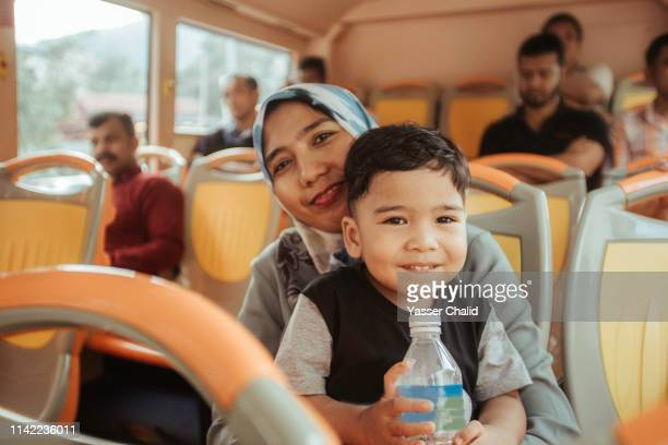 Mother and Toddler Son in a Bus