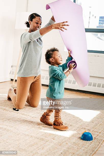 Mother and toddler with yoga pad