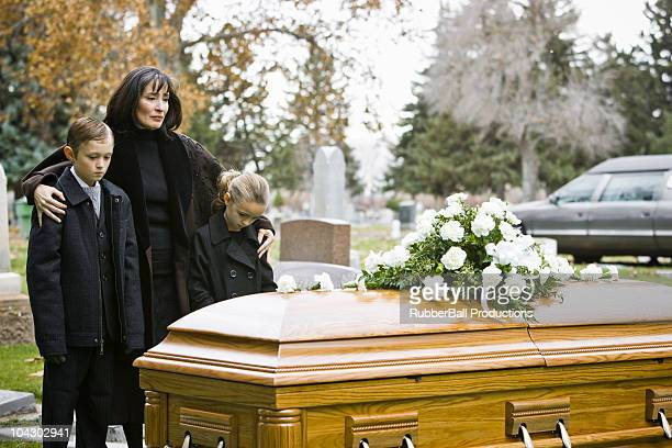 mother and two children at a funeral