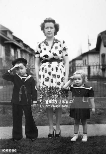 Mother and two children portrait, ca. 1944.