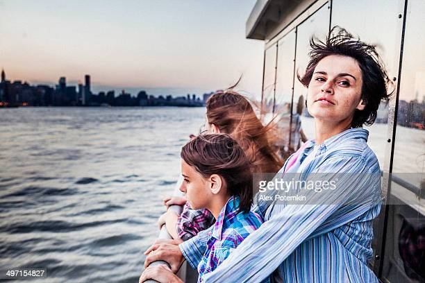 Mother and two daughters at ferry at Hudson River