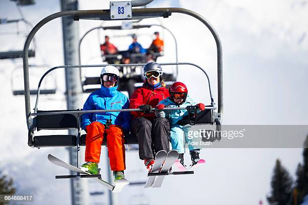 mother and two sons on ski lift - ski lift stock pictures, royalty-free photos & images