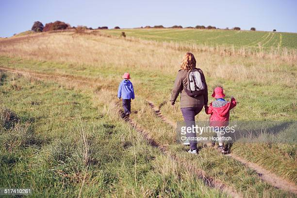 Mother and two young sons on a country walk