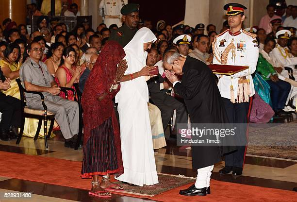 Mother and Wife of Sepoy Dharma Ram of Mahar Regiment stands to receive Shaurya Chakra from President Pranab Mukherjee during a Defence Investiture...