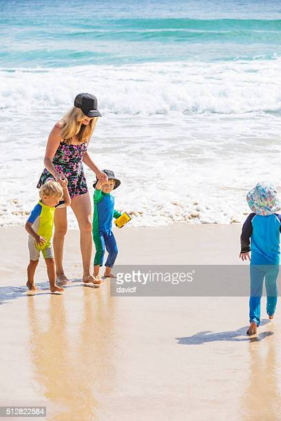 Mother and Young Boys Playing at the Beach