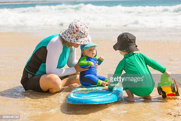 Mother and Young Children Playing at the Beach