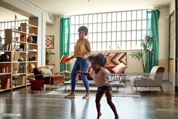 mother and young daughter doing dance fitness at home - modern stock pictures, royalty-free photos & images