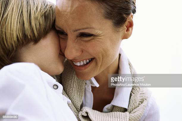 Mother and young son affectionately embracing
