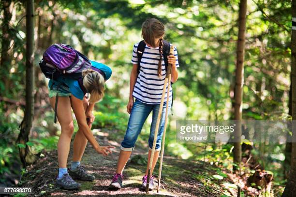 mother applying tick repellent on daughter - insect stock pictures, royalty-free photos & images