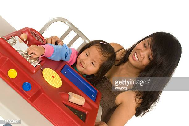 Mother assisting daughter with sensory station
