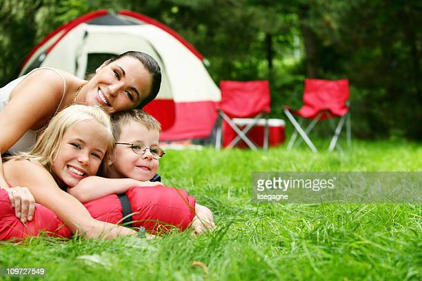 Mother at camping site with family
