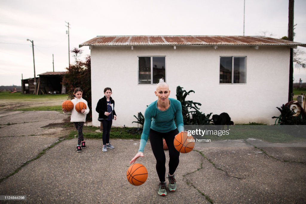 bald mother basketball coach