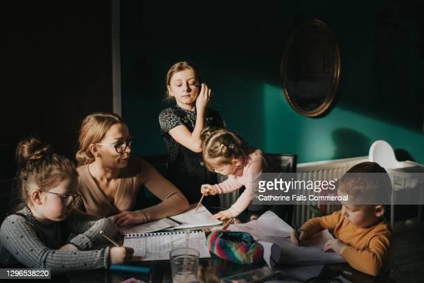 Mother attempting to Home school her 4 Children