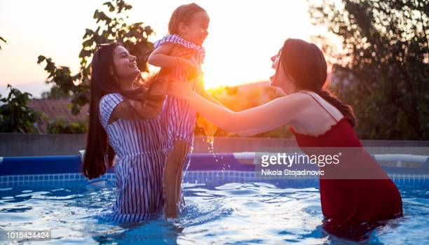 mother, aunt and girl at the pool - niece stock pictures, royalty-free photos & images