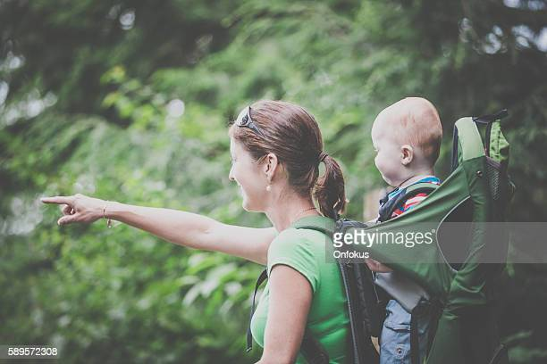 Mother Backpacking Hiking with Baby in Forest