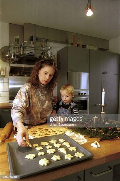 Mother bake with her child cookies