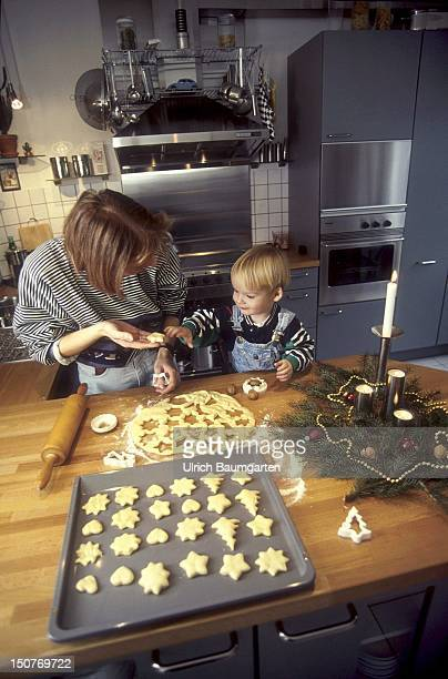 Mother baking cookies with her child