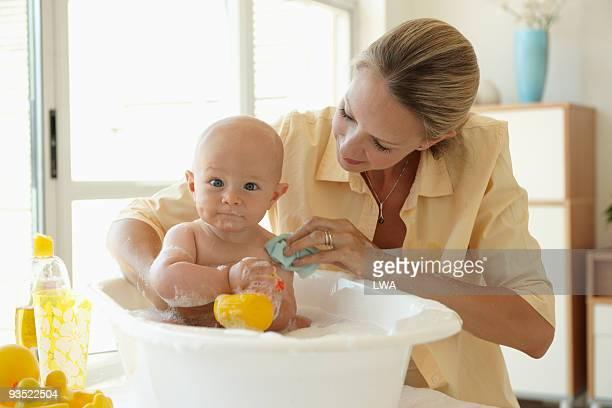 Mother Bathing Infant Son