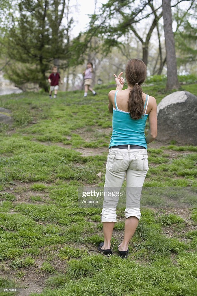 A mother beckoning her children in Central Park, New York City : Stock Photo
