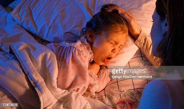 mother beside sick child - coughing stock photos and pictures