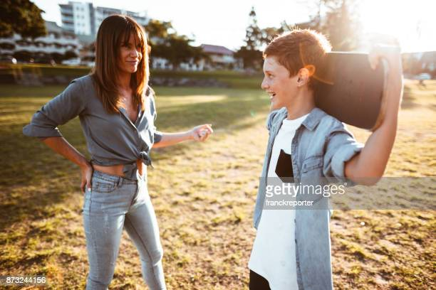 mother bothering the son with the skateboard