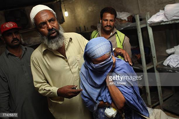 A mother breaks down after identifying the bodies of her two sons at the Edhi Foundation morgue October 20 2007 in Karachi Pakistan They were killed...