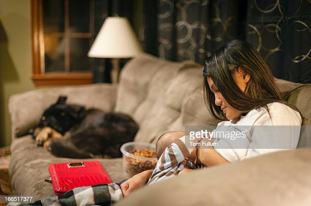 mother breastfeeding baby - woman breastfeeding animals stock photos and pictures