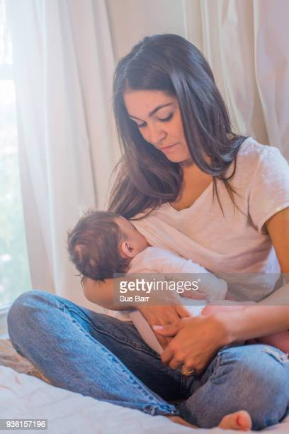 mother breastfeeding baby - young mom breastfeeding stock photos and pictures