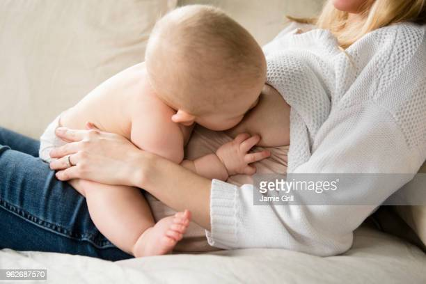 Mother breastfeeding baby (12-17 months)