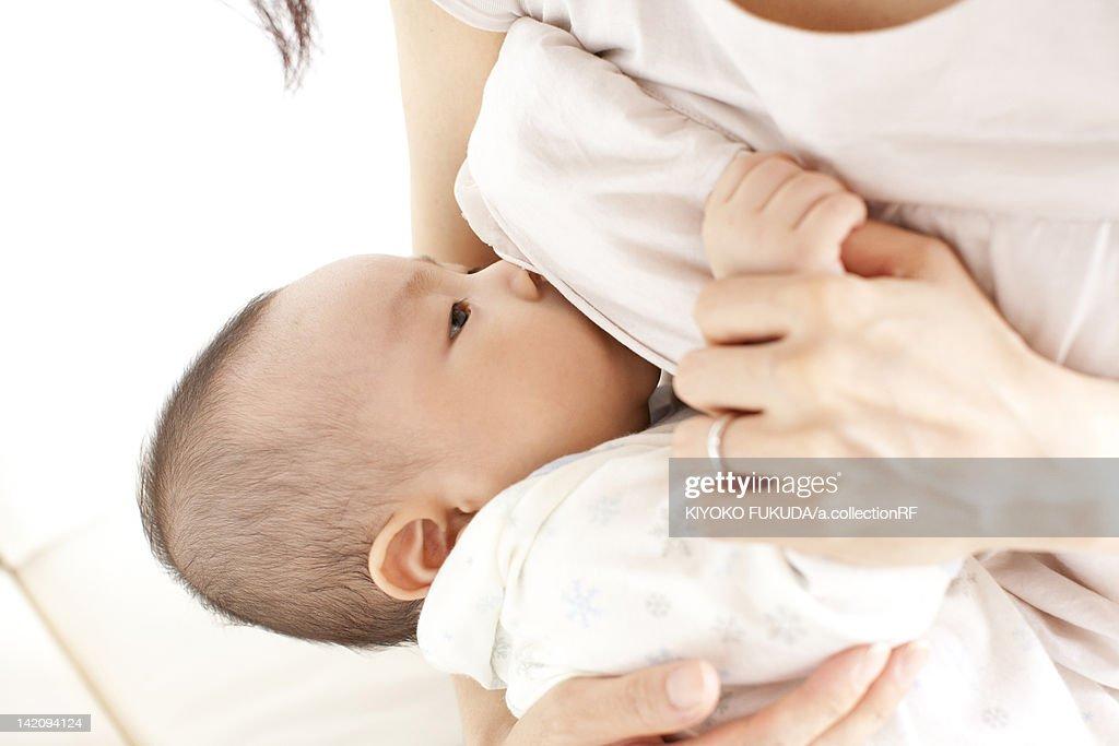 Mother breastfeeding daughter : ストックフォト